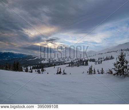 Picturesque Winter Windy And Cloudy Morning Alps. Highest Ridge Of The Ukrainian Carpathians Is Chor