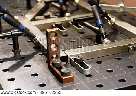Welding Platen Table With Fixtures And Jig Design. Selective Focus.