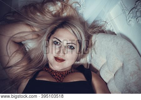 Attractive Plump Woman Laying On Sofa View From Top Studio Portrait.