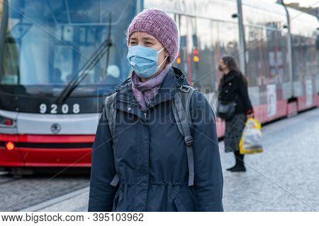 1/16/2020. Prague. Czech Republic. A Woman Wearing A Mask At Hradcanska Tram Stop During Quarantine.