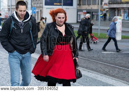 Czech Republic. A Young Couple Is Waiting For A Tram At Hradcanska Tram Stop During Quarantine. This