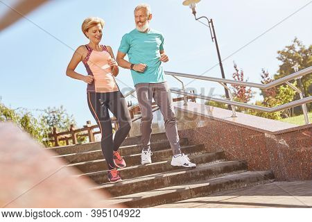 Healthier And Happier. Full Length Shot Of Active Mature Family Couple In Sportswear Looking Happy W