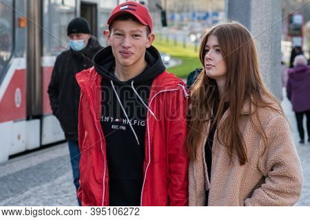 11/16/20. Czech Republic. A Young Couple Are Waiting For A Tram At Hradcanska Tram Stop During Quara