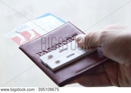 Covid-19 Test Cassette On Passport, Travel In The Time Of Coronavirus, Antibody Testing Upon Arrival