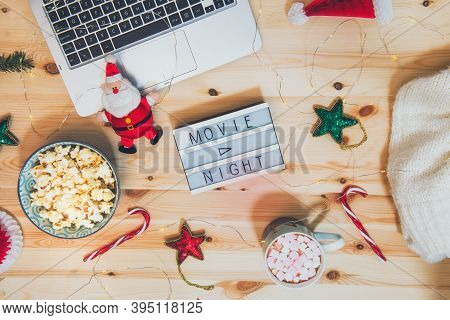 Top View Christmas Movie Night Concept. Flat Lay Composition With Movie Night Message On The Board,