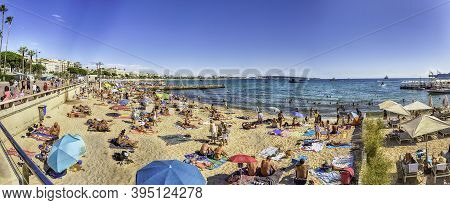 Cannes, France - August 15: People Enjoying A Sunny Day On The Beach In Cannes, Cote D'azur, France,