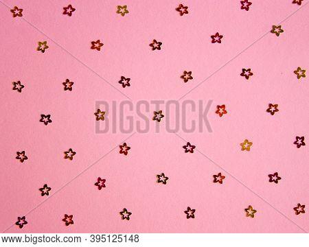 Festive Glitter Multicolored Pattern. Pink Background. Scattered Golden, Crimson And Orange Florets.