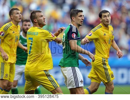 Lyon, France - June 16, 2016: Ukrainian (in Yellow) And Northern Ireland Players Fight For A Ball Du