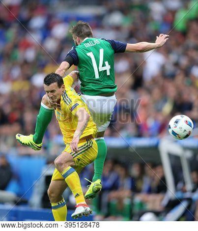 Lyon, France - June 16, 2016: Artem Fedetskiy Of Ukraine (l) Fights For A Ball With Stuart Dallas Of