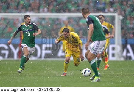 Lyon, France - June 16, 2016: Oliver Norwood Of Northern Ireland (l) Fights For A Ball With Yevhen S