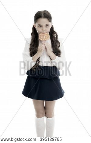 Healthy Nutrition Diet. Girl Pupil School Uniform Like Sweets Lollipop Candy White Background. Sweet