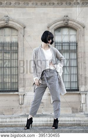 Stylish Outfit. Woman Fashionable Model Posing Outdoor. Girl Brunette Bob Hairstyle Looks Stylish. G