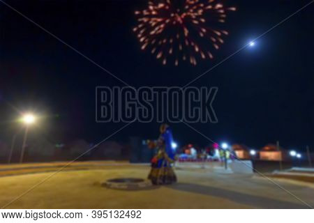 Blurred Image Of A Female Dancer Dancing, Dressed With Cultural Dress Of Rajasthan, Under Full Moon