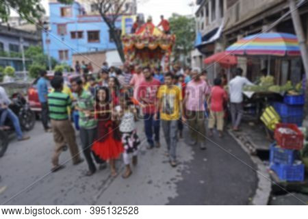 Blurred Image Of Young Bengali Hindu Devotees Dragging Holy Rope To Pull Rath, Chariot, Of God Jagan