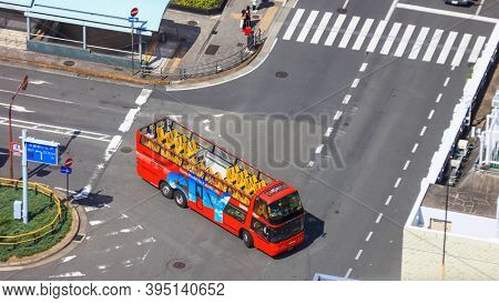 KYOTO, JAPAN - AUGUST 9, 2019 : Top view of Kyoto hop on hop off red bus , popular sightseeing transport option to major landmarks ,shrines and temples of Kyoto city in Japan.