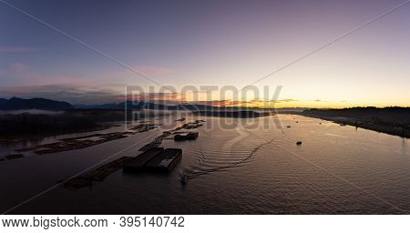 Aerial Panoramic View Of Fraser River. Dramatic Colorful Sunrise Sky. Taken Over Port Mann Bridge In