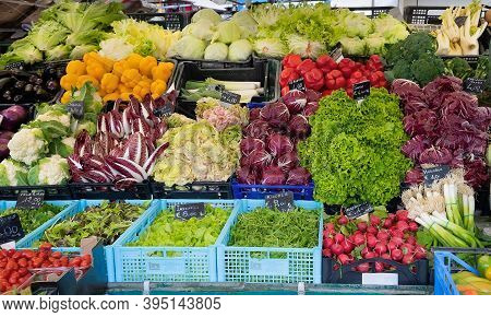 Display With Fresh Vegetables And Greens At Italian Market.