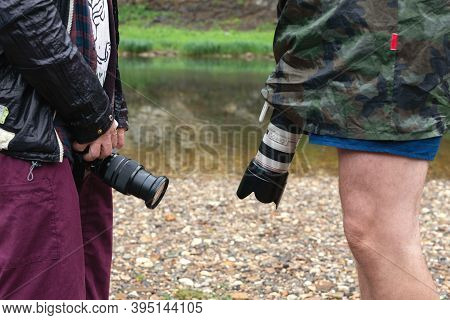 Professional Photographers Show Off To Each Other, Measure Size Of Slr Camera And Length Of Lens. Ru