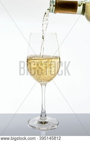 Pouring white wine from awine bottle