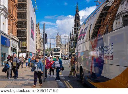 EDINBURGH,UK - AUGUST 13,2019 : Urban scene at Princes Street in Edinburgh with a view of several landmarks
