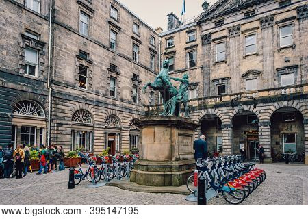 EDINBURGH,UK - AUGUST 14,2019 : The historic Edinburgh City Chambers with the famous statue of Alexander and Bucephalus