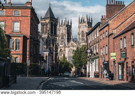 YORK,UK - AUGUST 11,2019 : Street scene in York with a view of the York Cathedral and several historic buildings