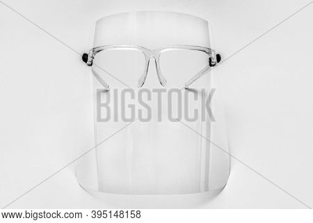 Eyewear with detachable face shield on a gray background
