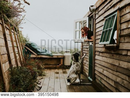 Woman talking with her dog