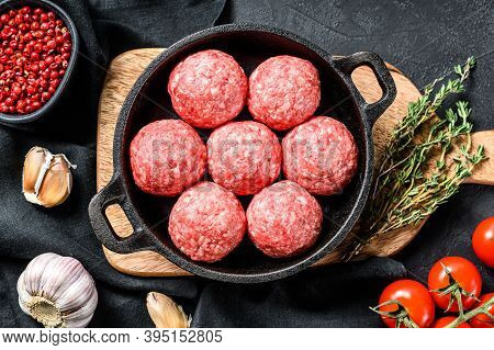 Cooking Meatballs From Minced Meat Pork In A Frying Pan. Black Background. Top View