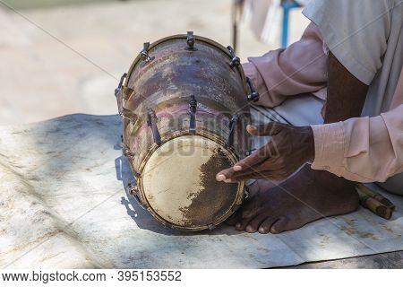 Indian Man Playing A Drum In The Hindu Temple, Rishikesh, India. Closeup