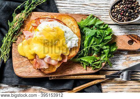 Breakfast Burger With Bacon, Egg Benedict, Hollandaise Sauce On Brioche Bun. Garnish With Arugula Sa