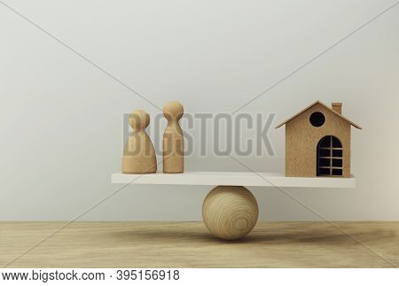 Family And House A Balance Scale In Equal Position. Family Financial Management, Cash Advance Concep