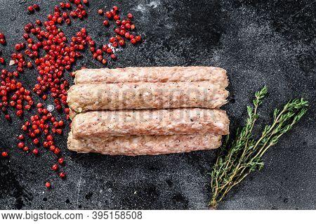 Raw Minced Beef Meat Kebabs. Black Background. Top View