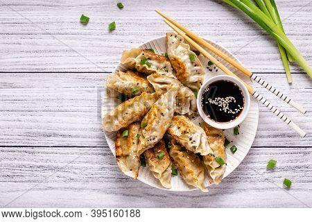 Fried Dumplings Gyoza With Soy Sauce, And Chopsticks, Top View.
