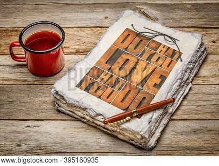 do what you love, love what you do - motivational word abstract - wood type lettering in a handmade sketchbook with a mug of tea, happiness, career and lifestyle concept