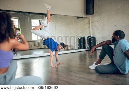 Teacher Showing A Handstand To His Students