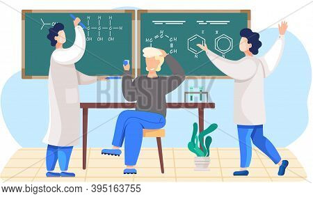 Chemistry Lesson In The School. Male Scientist Explains Formulas On A Blackboard. The Guy Sitting Wi