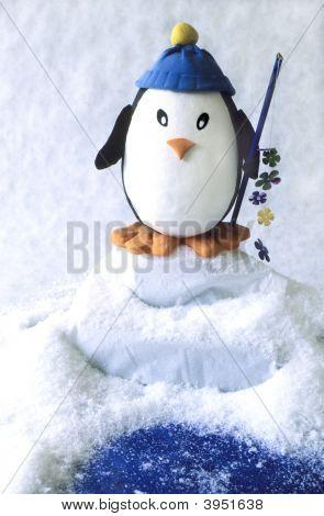 Toy Penguin Fishing From Iceberg