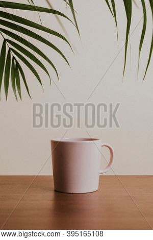 Earth tone color ceramic coffee cup on wooden table
