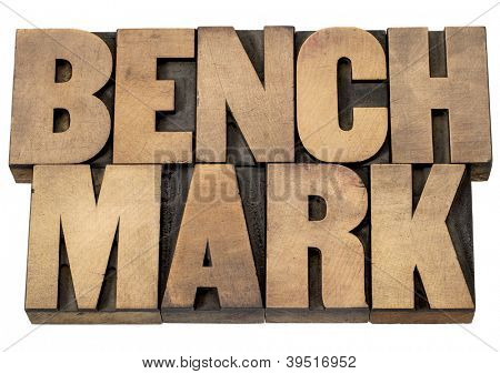 benchmark - isolated word in vintage letterpress wood type printing blocks