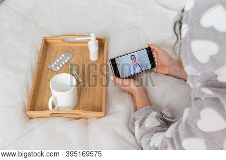 The Doctor Gives An Online Consultation To The Patient. The Woman In Quarantine Communicates With Th