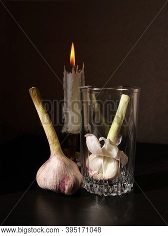 Retro Country Style Still Life With Two Garlic Bulbs, Beautiful Glass Beaker And Vintage Candlestick