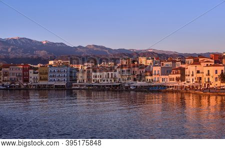 Sunrise At Old Venetian Harbour Of Chania, Crete, Greece, Shop, Hotels, Cafes And Restaurants On Its