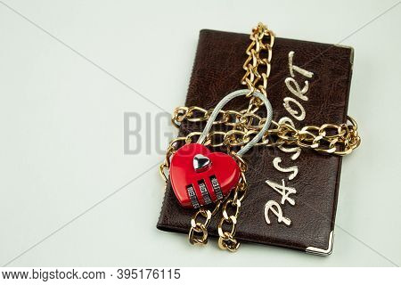 Code Lock With Chain On The Passport As A Symbol Of The Prohibition To Travel