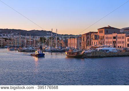 Fishing Boat Leaving Old Venetian Port Of Chania, Crete, Greece At Sunrise. Sailboats, Yachts, Grand