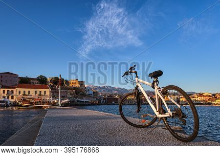 Early Morning In Old Venetian Port, Chania, Crete, Greece. Close-up Of Bicycle On Pier. Bicycle Tour