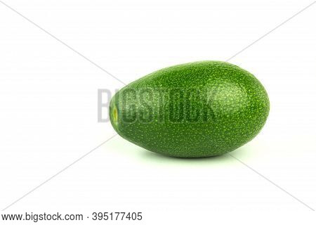 Fresh Green Avocado On A White Background. Diet And Healthy Avocado Close Up