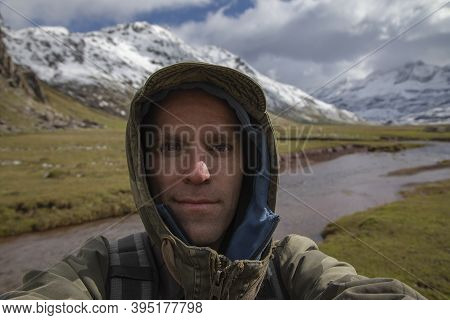 A Young Adult Man, Hiker Mountaineer, Taking A Selfie In The Aguas Tuertas Valley, Hecho, Anso, Hues