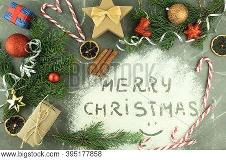 Merry Christmas Text Is Written On Flour While Baking Cookies. Text Merry Christmas In Flour On A Da