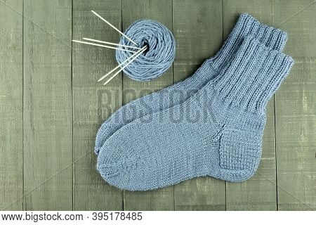 Warm And Beautiful Socks Knitted Of Woolen Threads